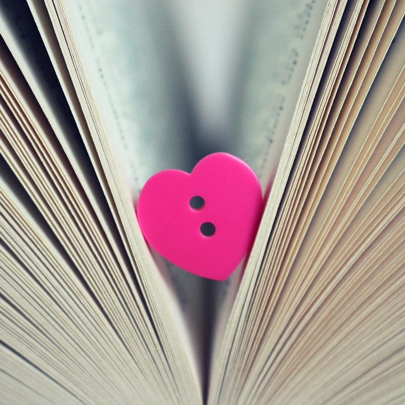 Pink heart button in a book - Check out my blog about loves and hates now